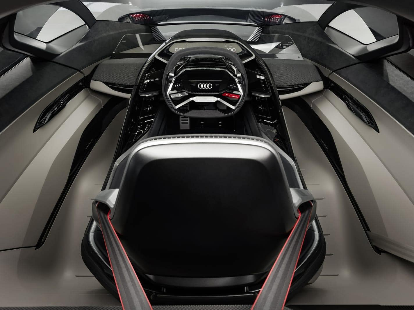<p>Der Fahrersitz lässt sich stattdessen dank einerseitwärts verschiebbaren Monocoque-Schale mittig positionieren.</p> Foto: AUDI AG
